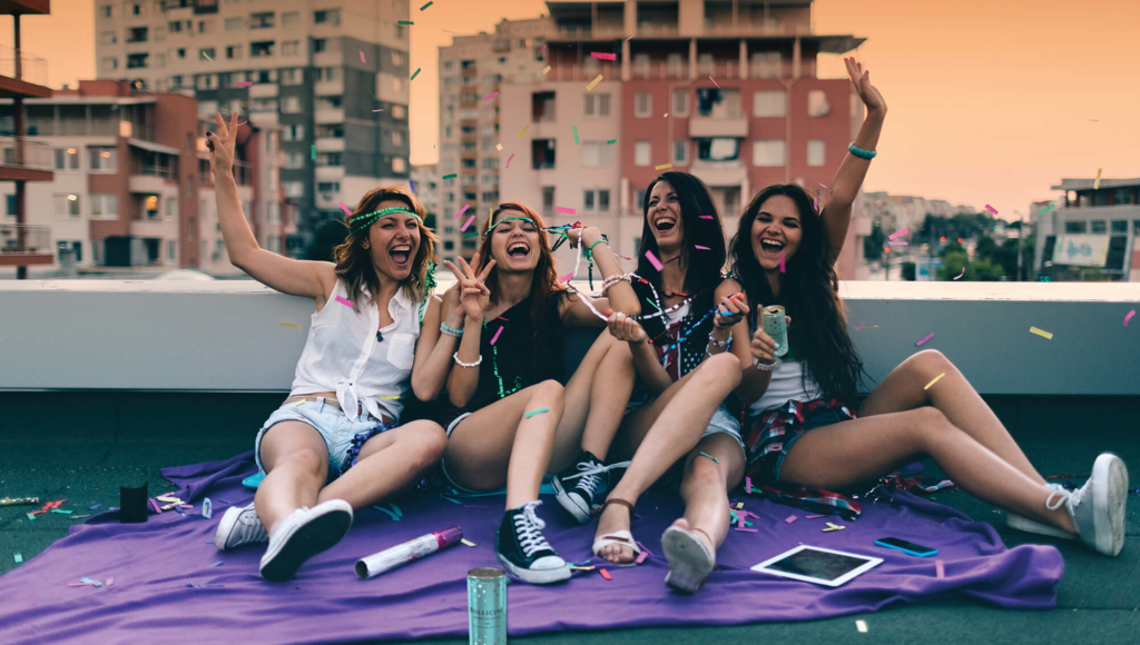 young people having party on roof with bollicini