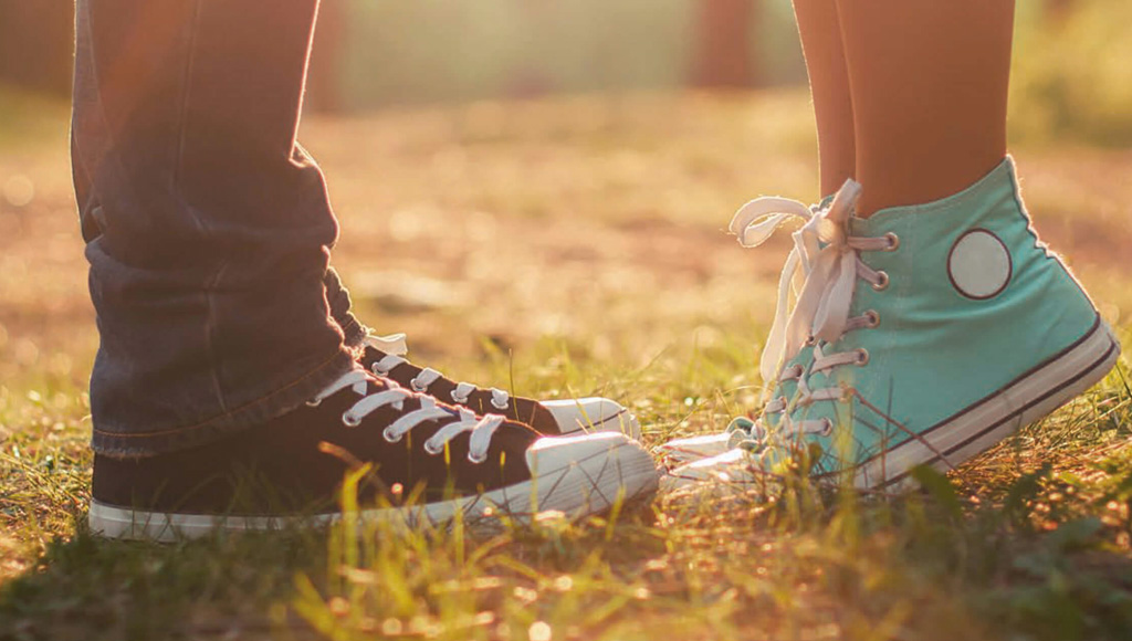 couple wearing converse shoes
